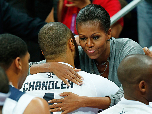 first-lady-michelle-obama-hugs-team-usa-center-tyson-chandler-reuters